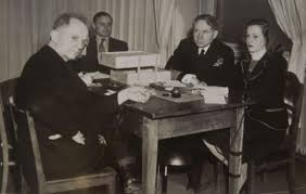 From left, Nuremberg Trials defendant German Navy Grand Admiral Karl Doenitz, unknown translator, Nuremberg trial Judge Michael Musmanno, and court reporter Vivian Spitz