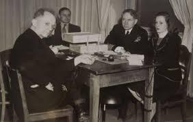 From left, Nuremberg Trials defendant German Navy Grand Admiral Karl Doenitz, unknown translator, Nuremberg trial Judge Michael Musmanno, and court reporter Vivian Spitz