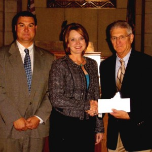 Pictured (L-R): Corey Steel, Nebraska court administrator; Julie L. Hurley, RMR, CRR; Chief Justice Michael Heavican
