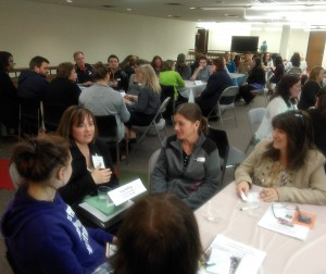 Suzy Rafferty, Tri-C student, talks to attendees during the speed networking session at the Tri-C open house