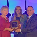 NCRA's Distinguished Service Award was presented to Bill Greenley's wife during the Premier Session