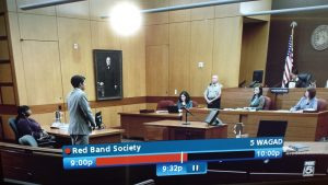 "A courtroom scene on the television series ""Red Band Society"" -- Shelley Duhon is the court reporter behind the bench."