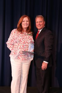 Karla Martin poses with Mayor Mark Mitchell after receiving her award