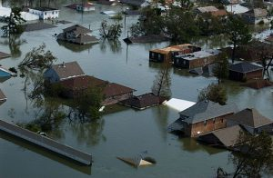 A nieghborhood in Louisiana is flooded after Hurricane Katrina. Only the roofs of the houses are visible above the water.
