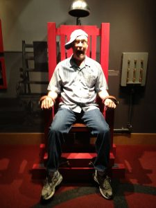 Kevin Daniel in the electric chair at the Mob Museum
