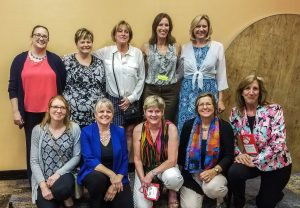 The captioning team for the 2018 HLAA Conference: back row: Megan Stumm, Angie Sundell, Lisa Richardson, Lori Morrow, and Whitney Riley; Front row: Kristi Artzen, Lisa Johnston, Deanna Baker, Lori Yeager Stavropoulos, and Sharon Vivian. (Not pictured: Jayne Carriker)