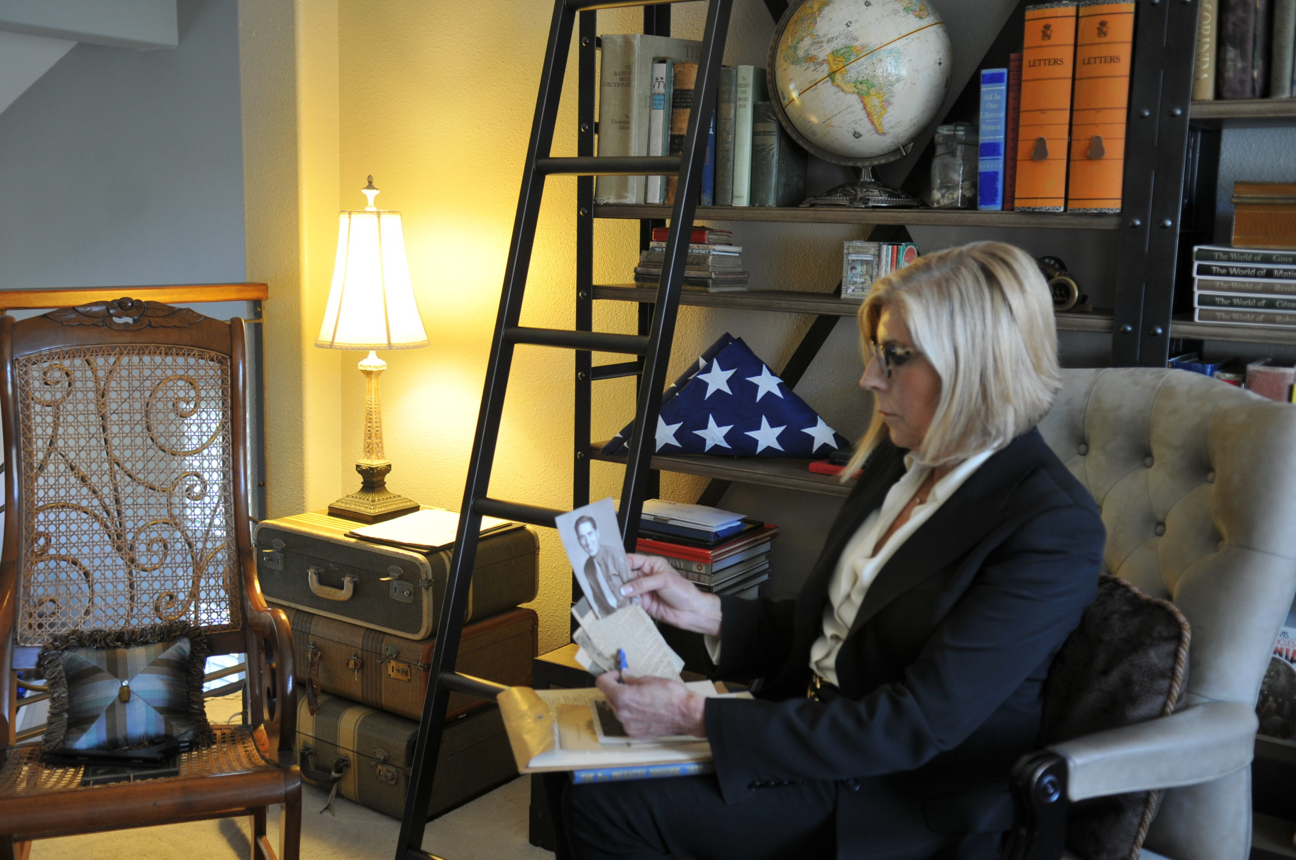 NCRF Chair Early Langley with photo of her uncle, a U.S. veteran who received the Purple Heart